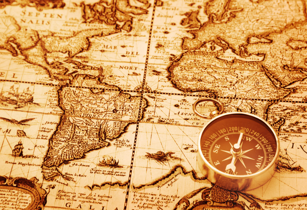 An old map of showing the equator line with a compass